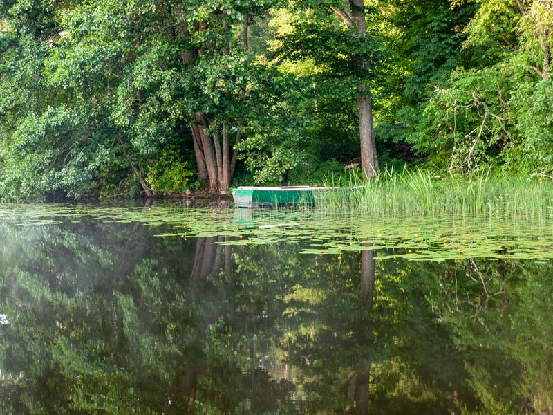 The boat docked in the lake, stock photography