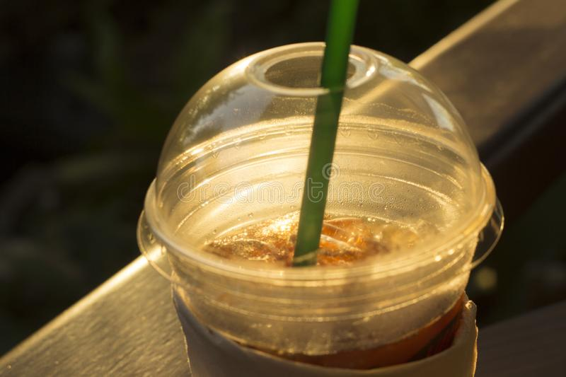 Morning Closeup of Iced coffee in plastic take away glass.  stock photo