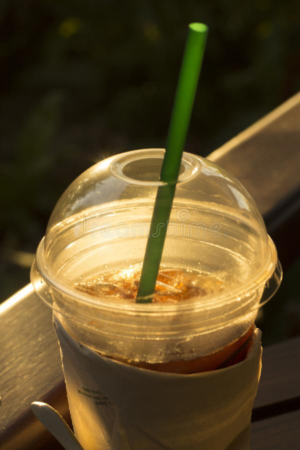 Morning Closeup of Iced coffee in plastic take away glass.  royalty free stock photos