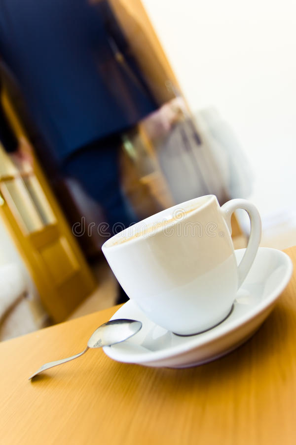 Morning coffee. Businessman leaving home after a breakfast stock images