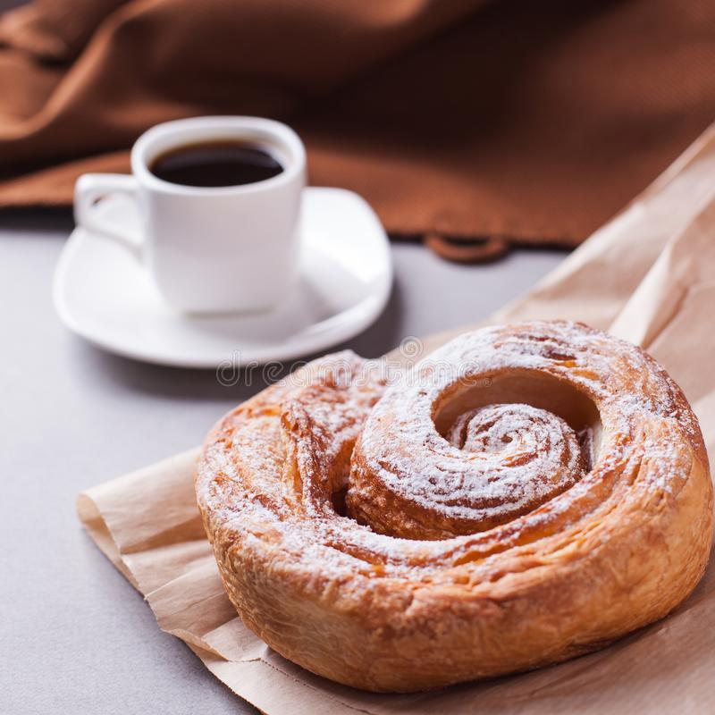 Morning coffee and biscuit - high-calorie breakfast, unhealthy food, modern bad habits, caffeine and fast carbohydrates. stock photo