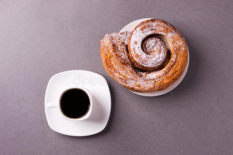 Morning coffee and biscuit - high-calorie breakfast, unhealthy food, modern bad habits, caffeine and fast carbohydrates. Morning coffee and biscuit - high royalty free stock photo