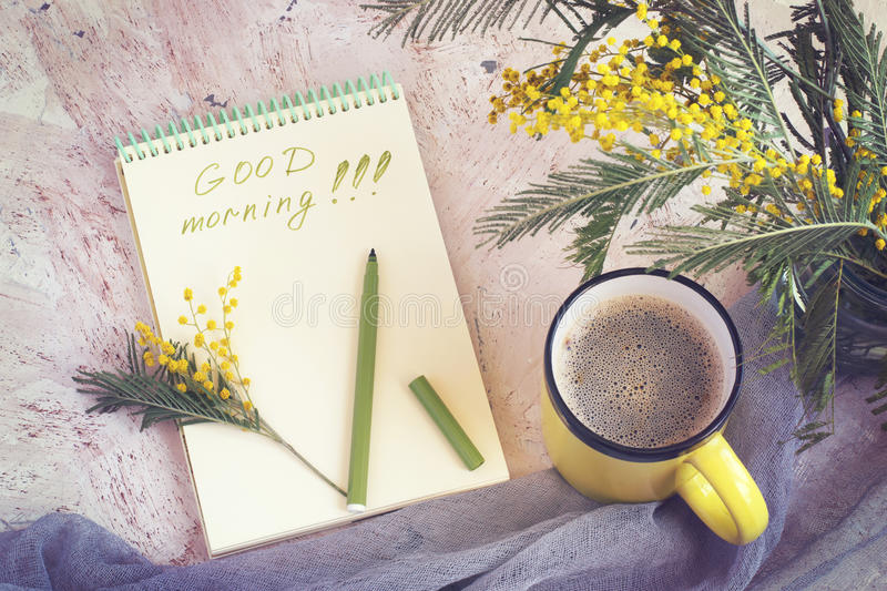 Morning coffee, a bouquet of mimosas and a good morning`s wish,. Toned royalty free stock images