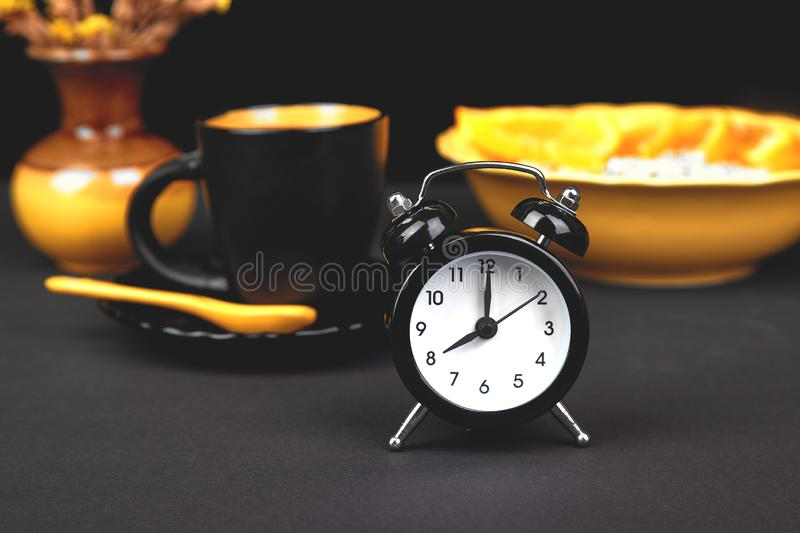 Morning coffee, breakfast with fruit near alarm clock royalty free stock photos