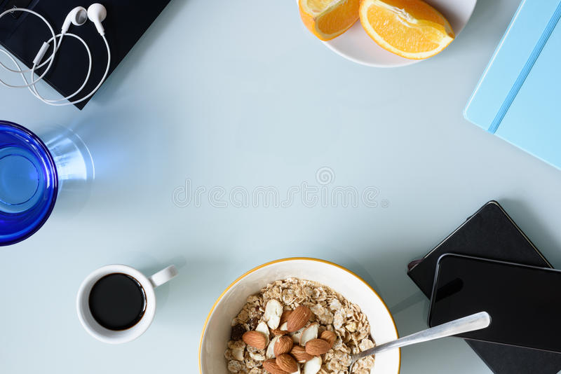 Morning coffee, breakfast, laptop on glass table. Top view, copy space. stock photo