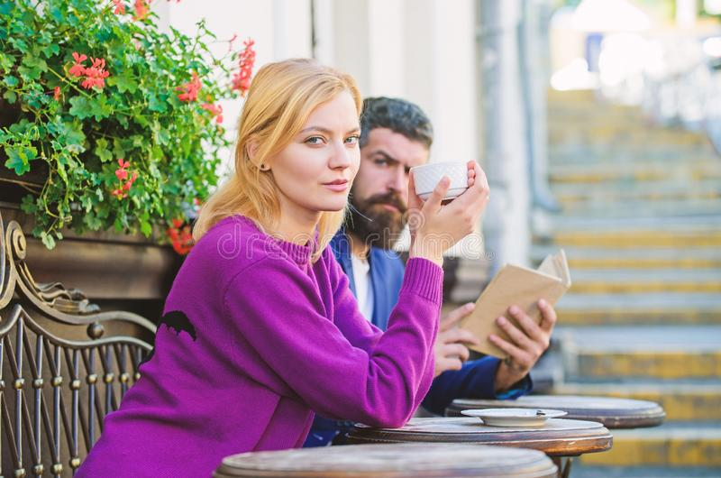 Morning coffee. Couple in love on romantic date. First meet of girl and mature man. Brutal hipster and girl drink coffee stock image