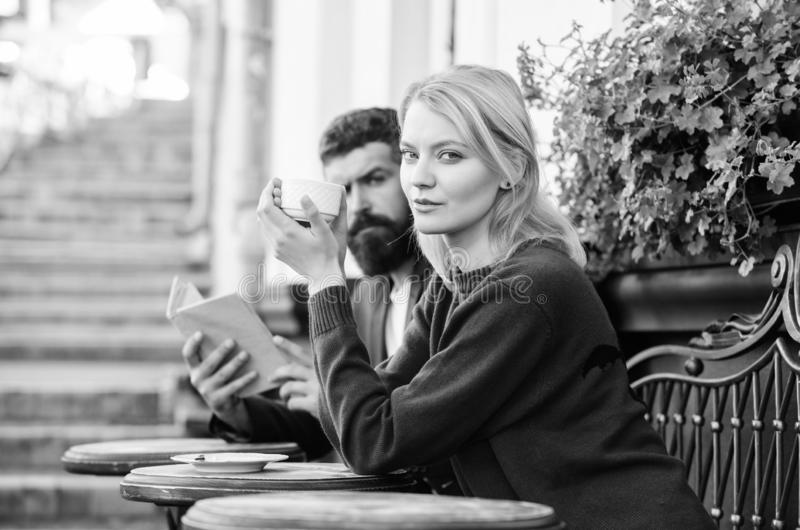 Morning coffee. Couple in love on romantic date. First meet of girl and mature man. Brutal hipster and girl drink coffee royalty free stock photo