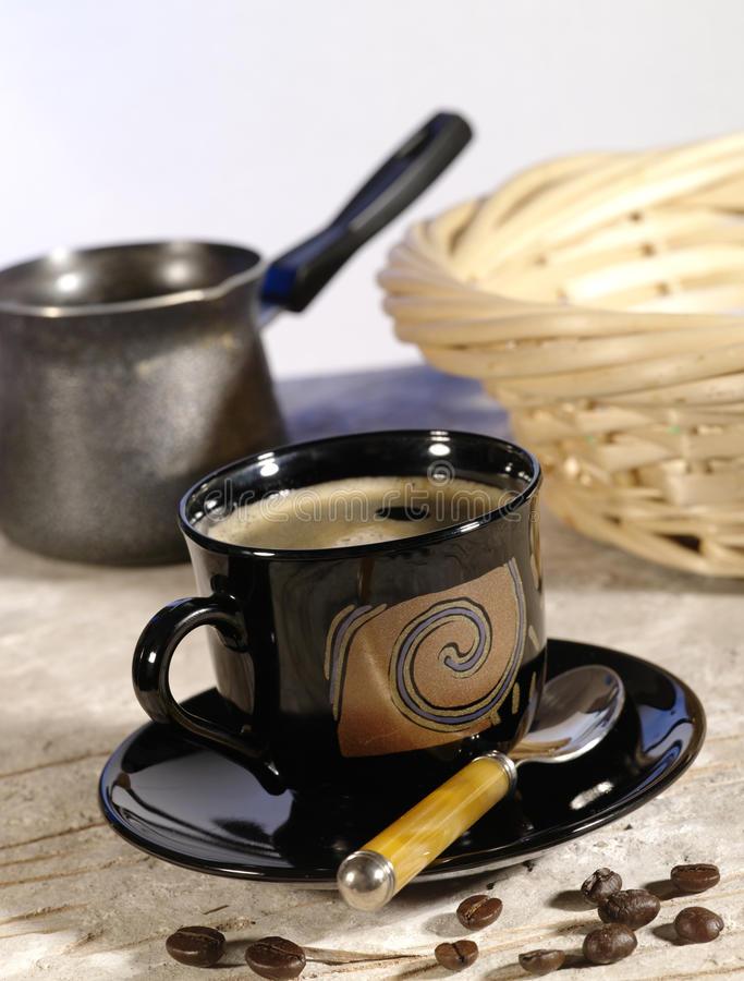 Morning coffee. Cup of espresso. Coffee pot and beans. Lite blue backlight stock photos
