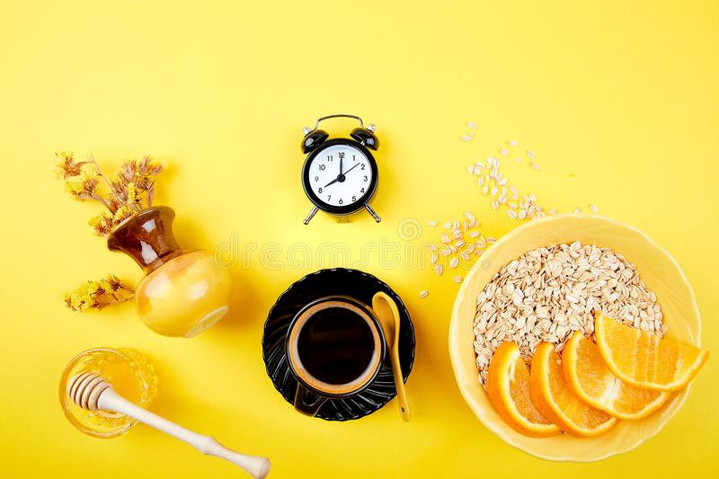 Morning coffee, granola breakfast, alarm clock royalty free stock photo