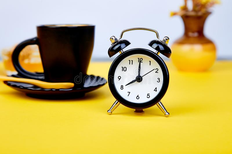 Morning coffee, granola breakfast, alarm clock stock image