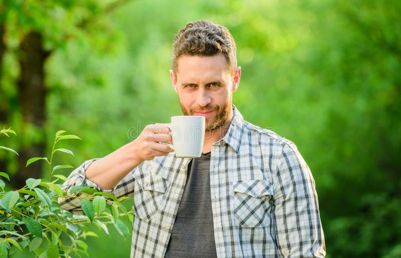 Morning coffee. healthy lifestyle. nature health. ecological life for man. man in green forest. breakfast refreshment stock photo