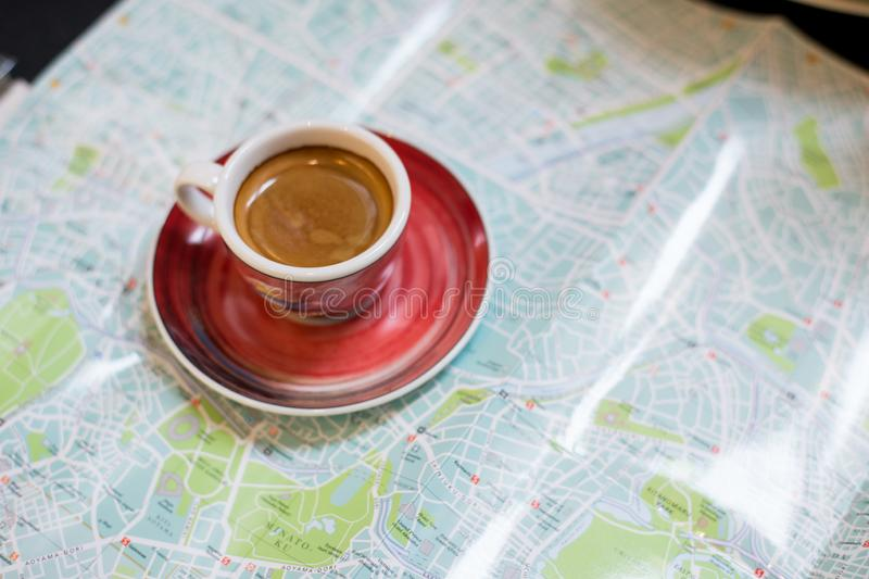 Morning coffee with map for travelmorning coffee in mini cafe with map for travel guide royalty free stock photos