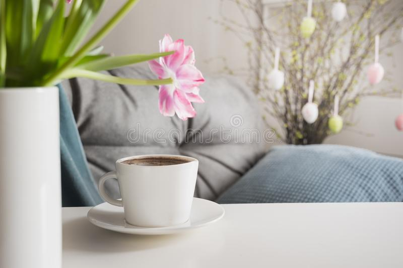 Morning coffee in spring interior. Easter Party Planning stock photography