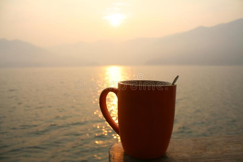 Morning coffee and sunrise. Close up Morning coffee and sunrise royalty free stock image