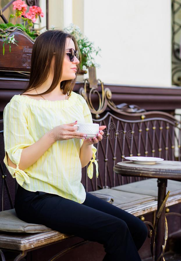 Morning coffee. Waiting for date. stylish woman in glasses drink coffee. good morning. Breakfast time. girl relax in. Cafe. Business lunch. summer fashion stock photo