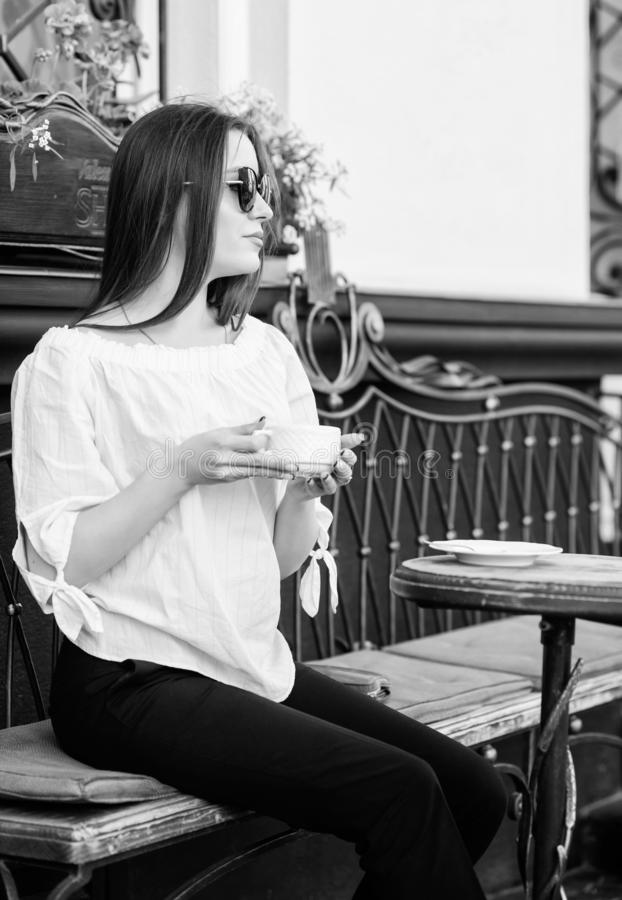Morning coffee. Waiting for date. stylish woman in glasses drink coffee. good morning. Breakfast time. girl relax in stock photography