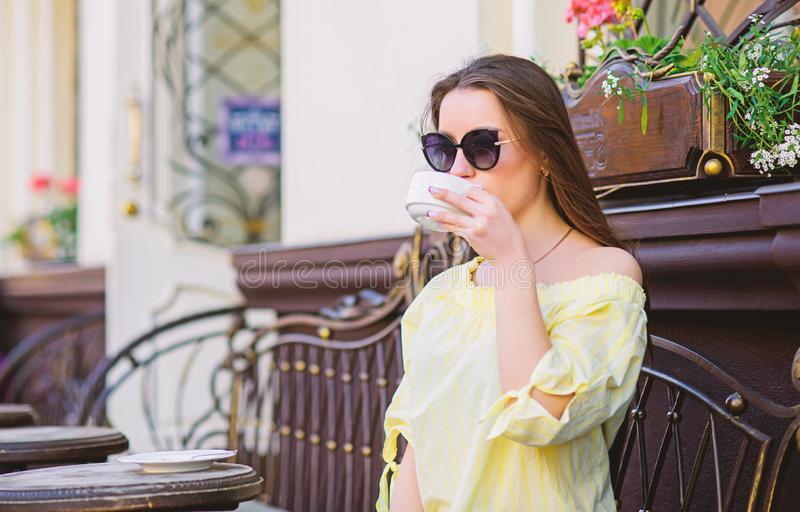 Morning coffee. Waiting for date. stylish woman in glasses drink coffee. summer. Lucky to start the day here. Meeting in royalty free stock photography