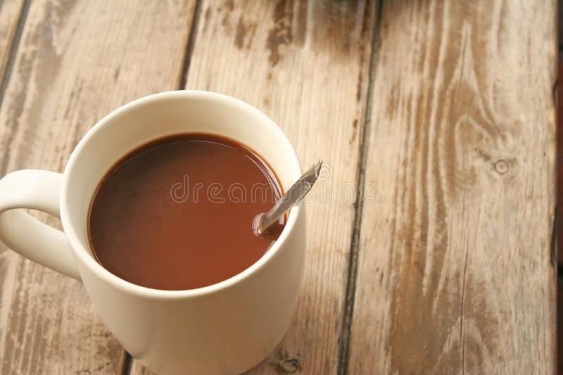 Morning coffee on wood table. Close up Morning coffee on wood table royalty free stock image