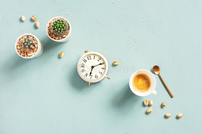 Morning composition with cup of hot coffee and clock stock image