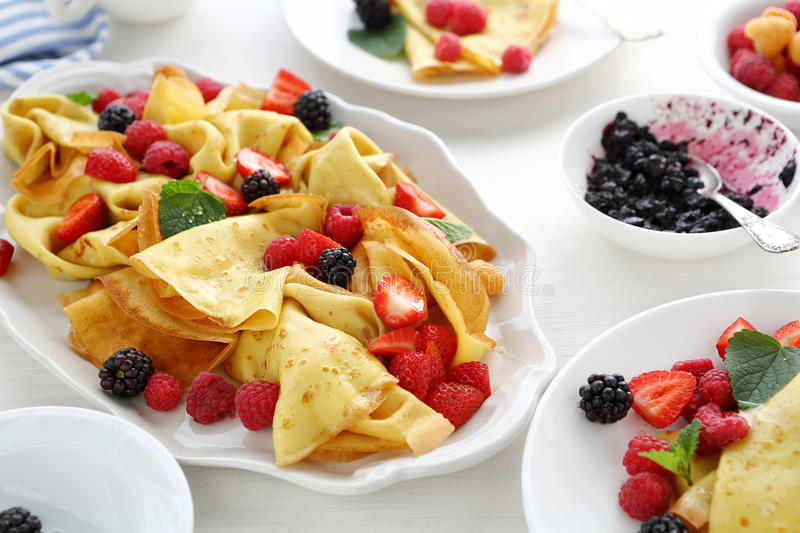 Morning crepes with fresh berries royalty free stock photography