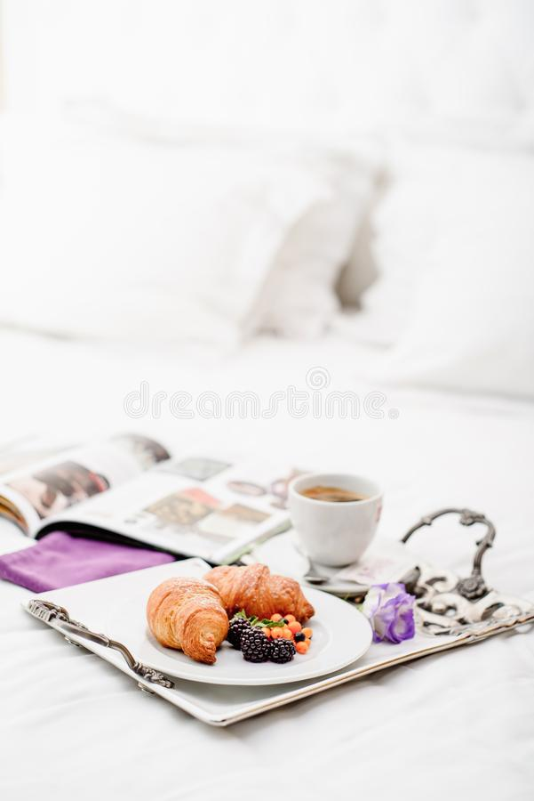 Morning with croissant breakfast with berries and coffeee stock images