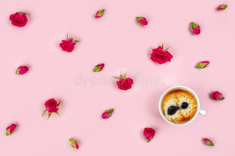 Morning Cup of coffee and a beautiful roses on pink background, top view. Pink background with a Cup of coffee surrounded by flowers. Flat lay, top view stock image