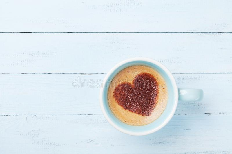 Morning cup of coffee with heart on foam. Cozy breakfast. Top view. Morning cup of coffee with heart on foam. Cozy breakfast royalty free stock photography