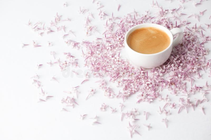 Morning Cup of coffee and a lilac flowers on light background, top view. Cozy Breakfast. Flat lay style. Female woman day, mother royalty free stock photos