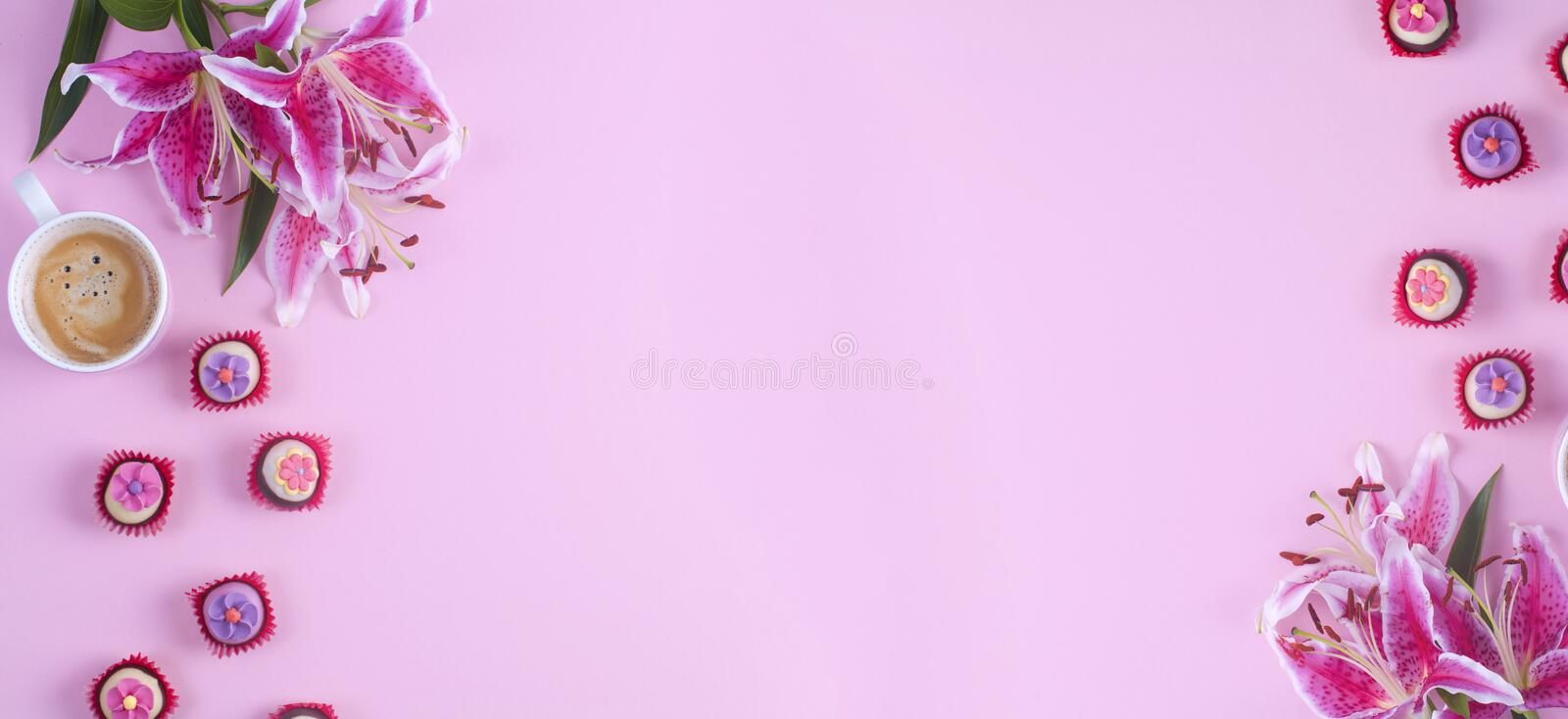 Morning cup of coffee, sweet, flower on pink table from above. Beautiful breakfast. Flat lay style. Banner. Place for text royalty free stock photography