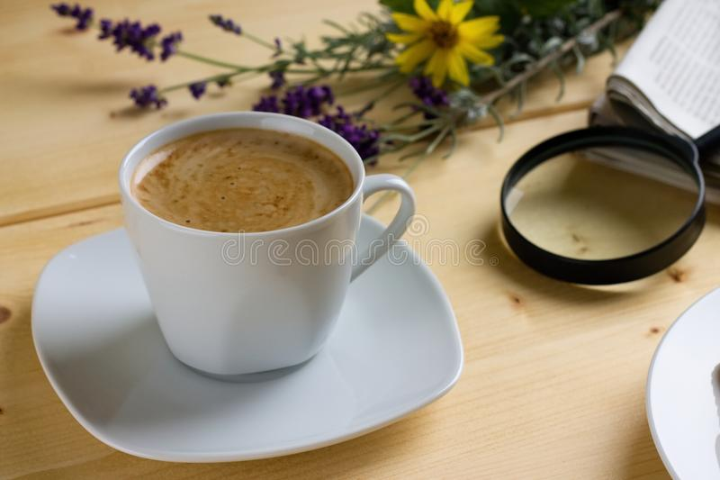 Morning cup of coffee on wooden table royalty free stock photography