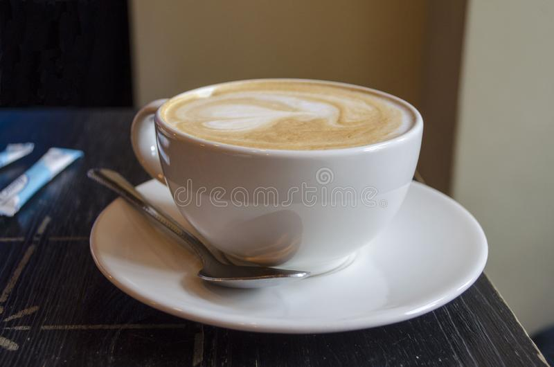 Morning cup of fresh coffee close up. In cafe royalty free stock image