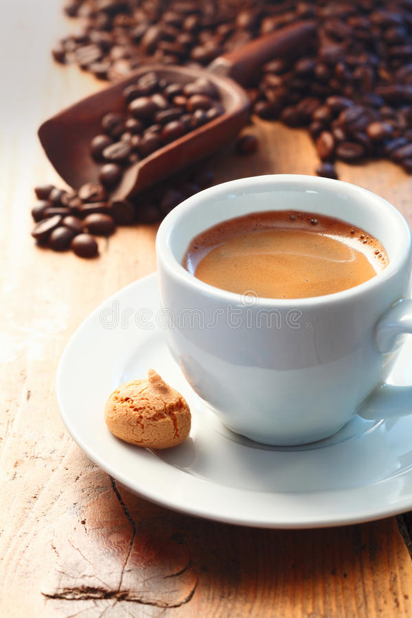 Morning cup of frothy espresso coffee stock photo