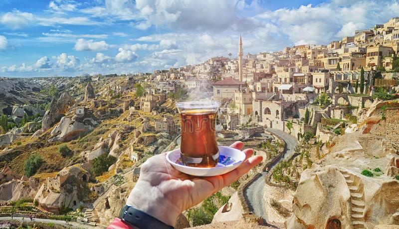 Morning cup of tea with view of ancient Nevsehir cave town stock images