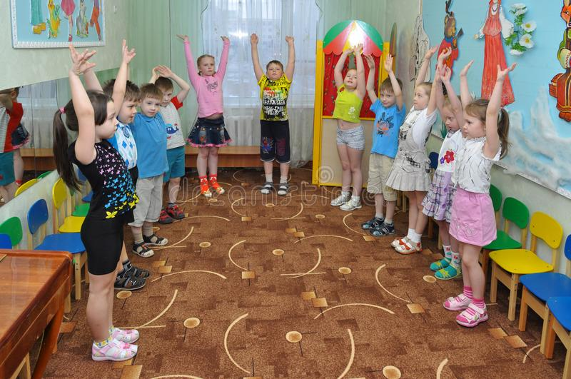 Morning exercise in children in a small group of kindergarten. Gadjievo, Russia - April 21, 2011: Morning exercise in children in a small group of kindergarten royalty free stock photos