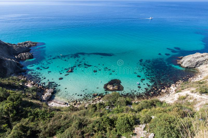 Morning on Fiolent cape region. Bird`s-eye-view on sea with floating motor yacht royalty free stock images