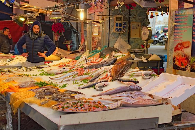 Morning in fish market. Fresh seafood and fish shop at famous local market Ballaro in Palermo royalty free stock photo