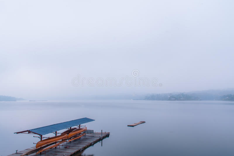 Morning fog. Along the waterfront stock photography