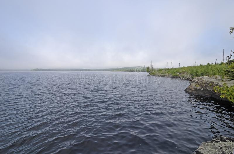 Morning Fog Almost Gone. On Little Saganaga Lake in the Boundary Waters in Minnesota stock photo
