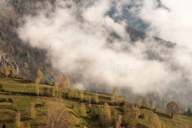 Morning fog on the mountains in Romania stock photos