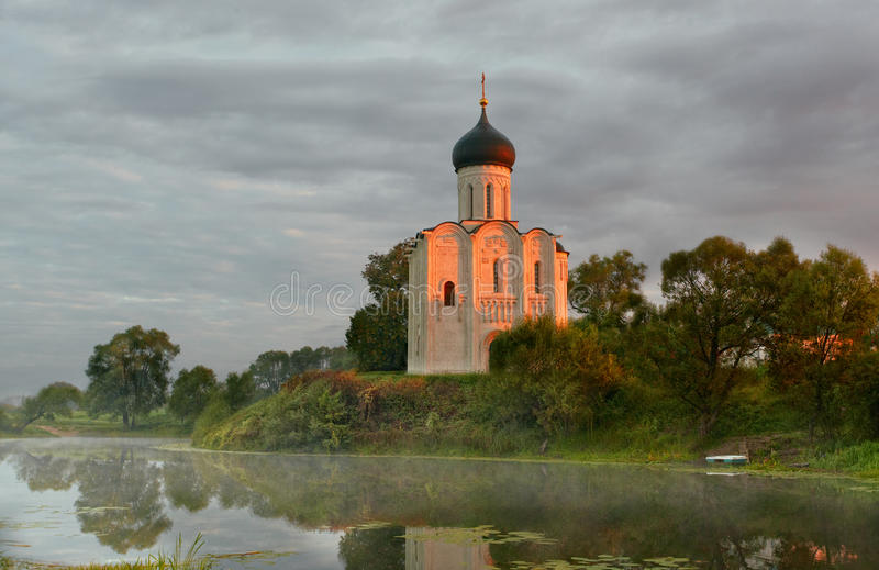 Morning fog over a pond near the temple of the Intercession on Nerli stock images