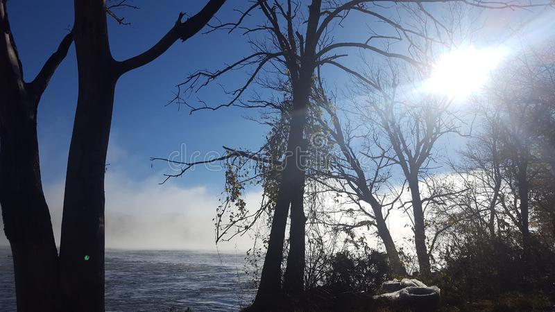 Morning fog over the river water royalty free stock photos