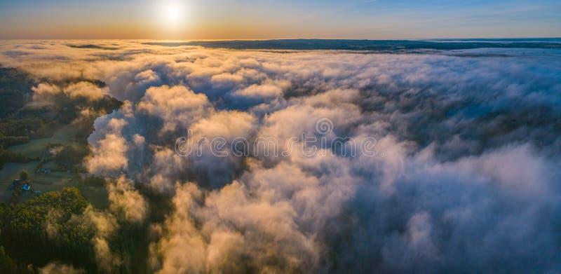 Morning fog over woodland. Summer nature landscape aerial panorama. Nature sunlight scene at foggy sunrise. Sea of fog. royalty free stock image
