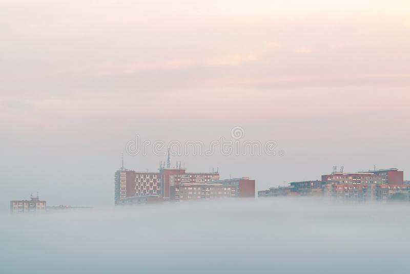 Morning fog under buildings in the city Zlin, Czech Republic. Minimalistist Photography. Morning fog under buildings in the city Zlin, Czech Republic, Europe royalty free stock images