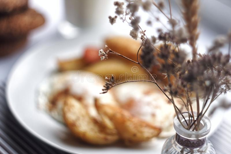 Morning food and dry flowers stock image