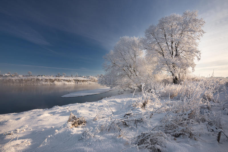 Morning Frosty Winter Landscape With Dazzling White Snow And Hoarfrost, River And A Saturated Blue Sky.Winter Small River On A Sun stock photos
