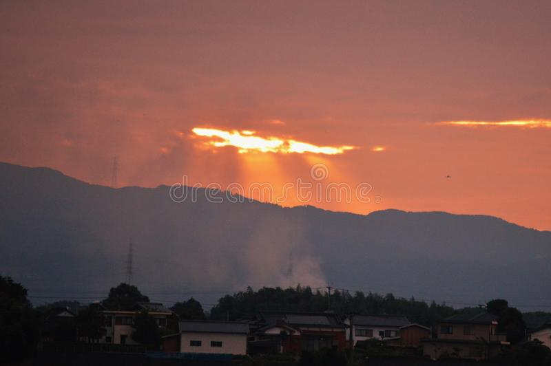 Morning glow. Crossing birds flocking in the sky dyed red in the morning glow and the sound of the water flowing in the Chikugo River can be heard. Today is a royalty free stock photo