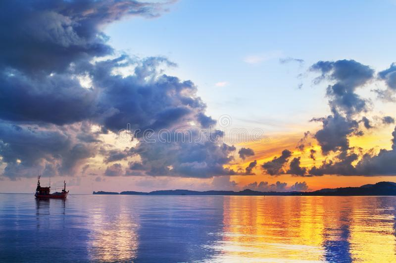 Morning golden sunrise on blue sea, ship silhouette and clouds scenic landscape, scenery ocean bright colorful sunset, Thailand stock images