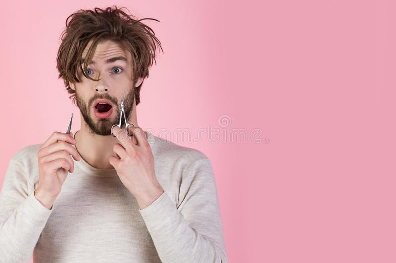 Morning, hair care, everyday life. Man with disheveled hair grooming in morning. Barber and hairdresser, male fashion. Man trimming beard hair with scissors stock photo
