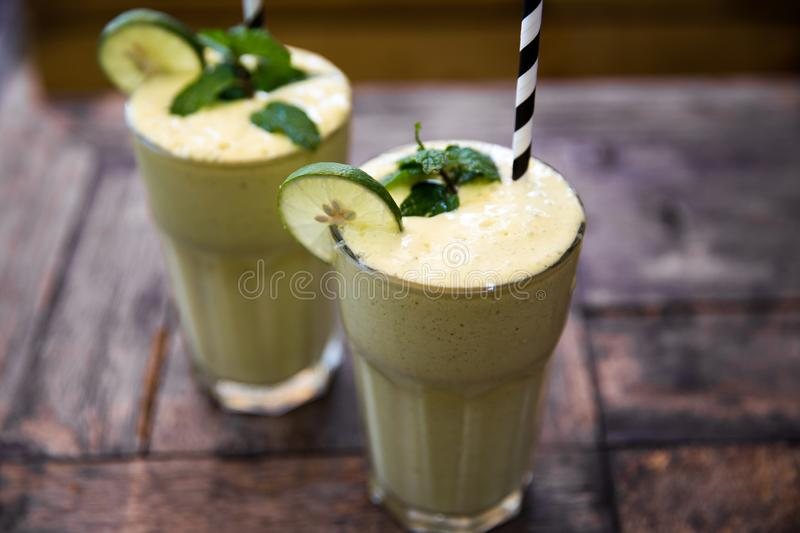 Morning healthy breakfast smoothie drink made of super foods, fruits, mint stock images