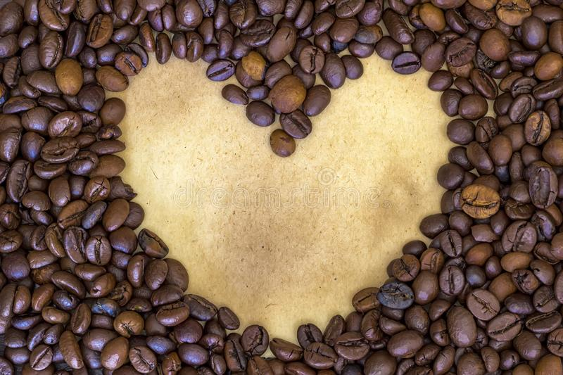 Heart shape made from coffee beans royalty free stock photos